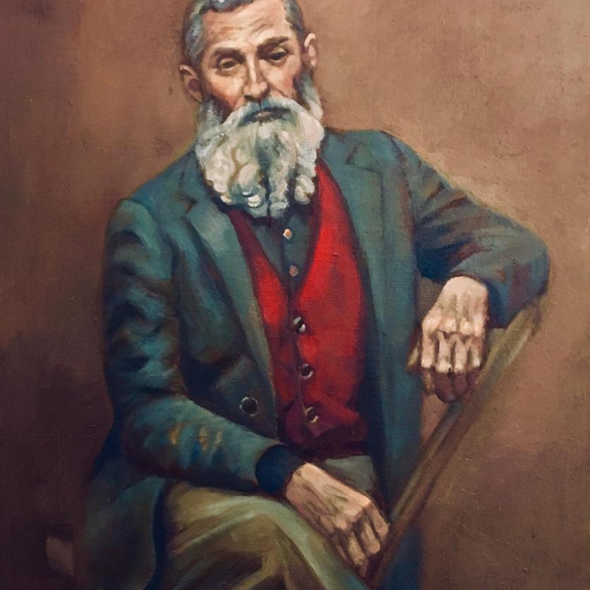 a bearded pointed head man